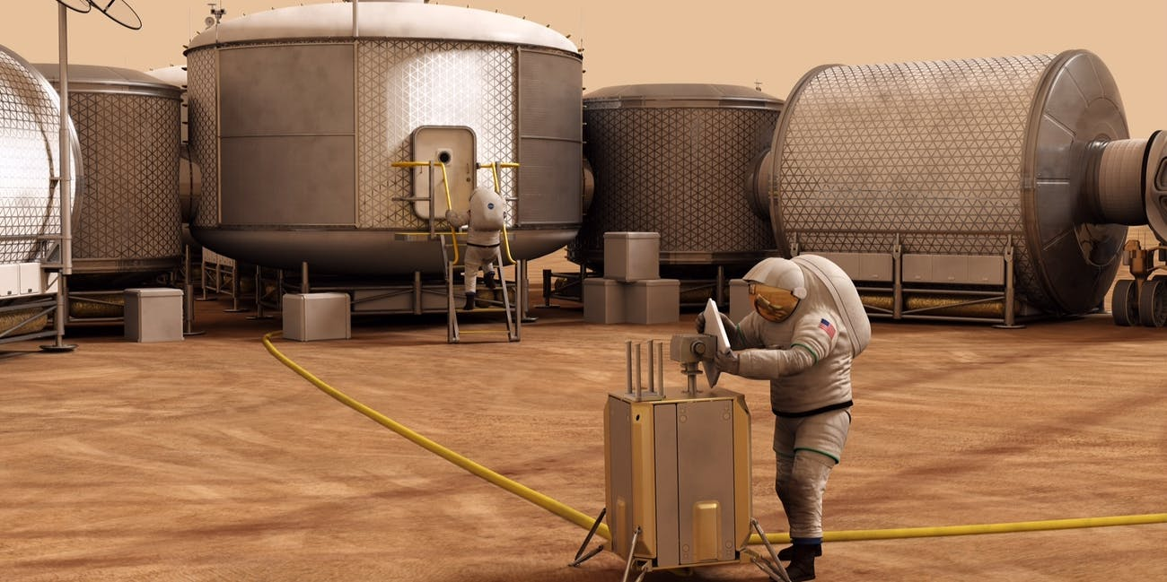 Artist concept of astronauts working on Mars.