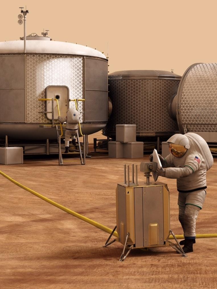 Artist concept of astronauts working on Mars.