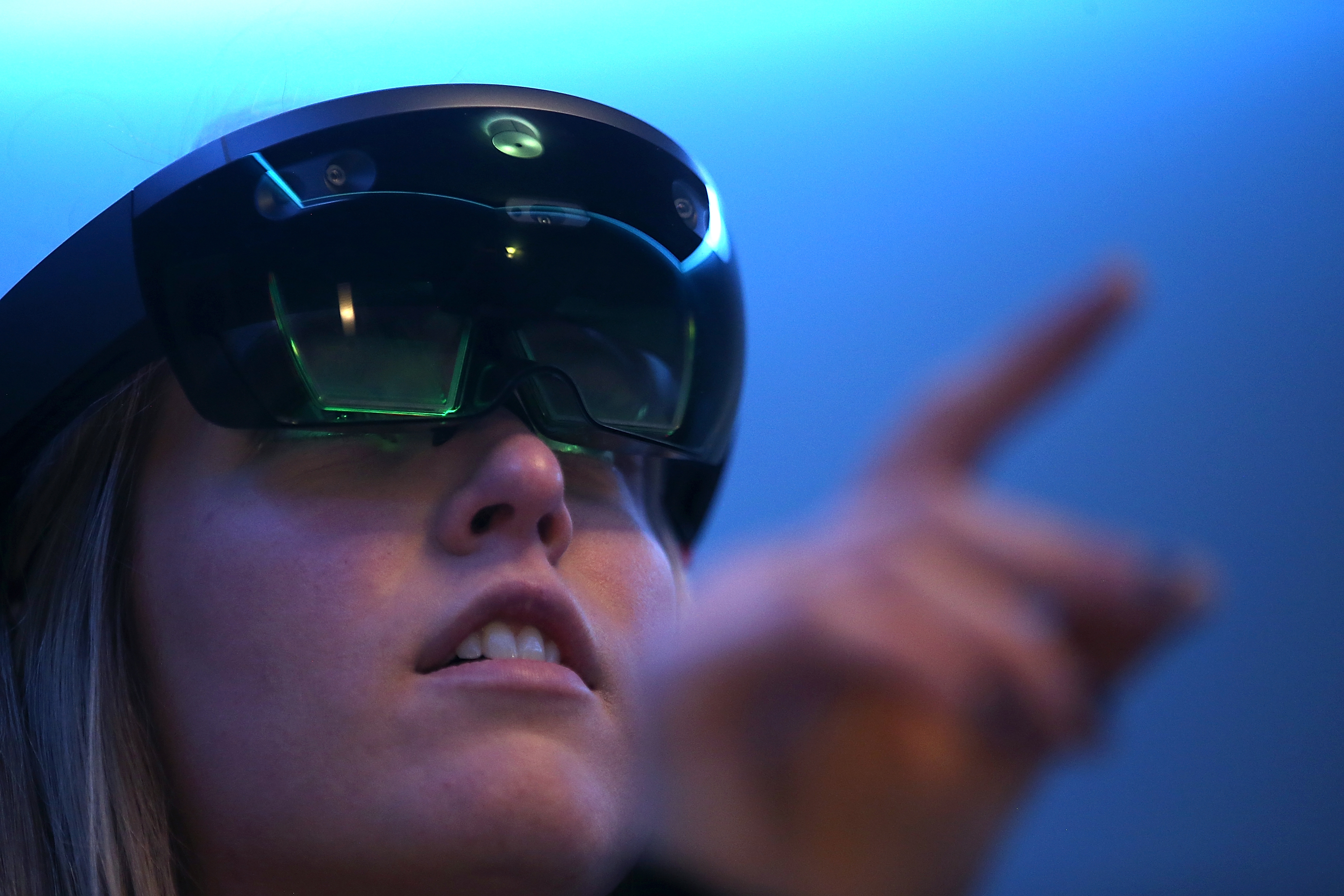 To view virtual reality, users have to use headsets like Microsoft's HoloLens.