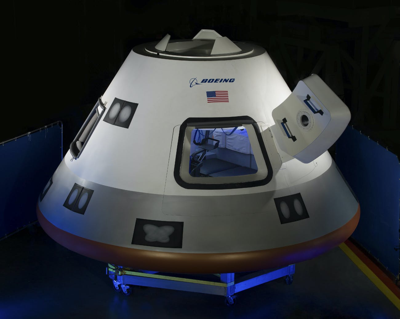 Boeing unveils a mockup of its CST-100 Starliner in July 2013 at the Houston Product Support Center in Texas. Six years after this design was unveiled, it still has yet to fly any humans.
