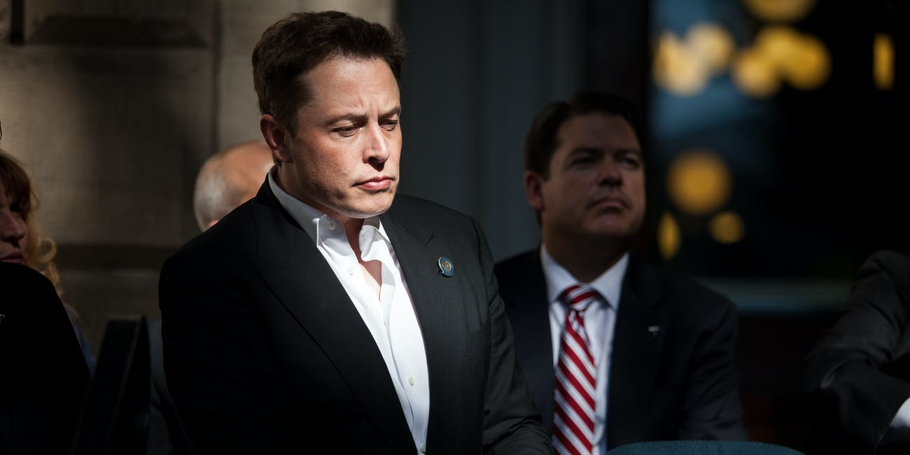 CARSON CITY, NEVADA- SEPTEMBER 4: Elon Musk, CEO of Tesla Motors, listens as Governor Brian Sandoval of Nevada speaks during a press conference at the Nevada State Capitol, September 4, 2014 in Carson City, Nevada. Musk and Sandoval announced a plan to build a Tesla Gigafactory in Nevada to produce batteries for electric vehicles providing 6,500 jobs to the state. (Photo by Max Whittaker/Getty Images)