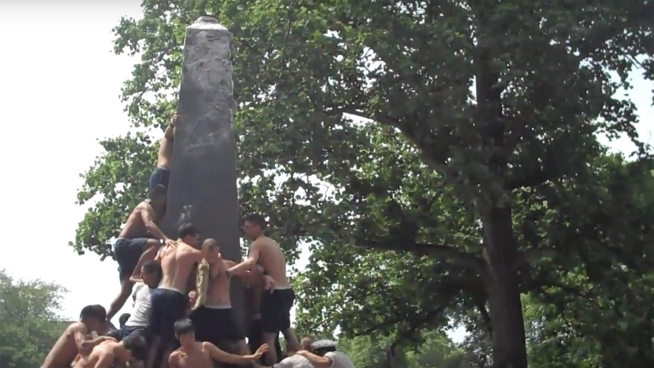 Shirtless Plebes Climb A Greasy Pole In Naval Academy's Annual Herndon Climb