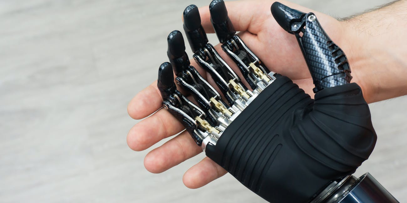 Robot hand in human hand