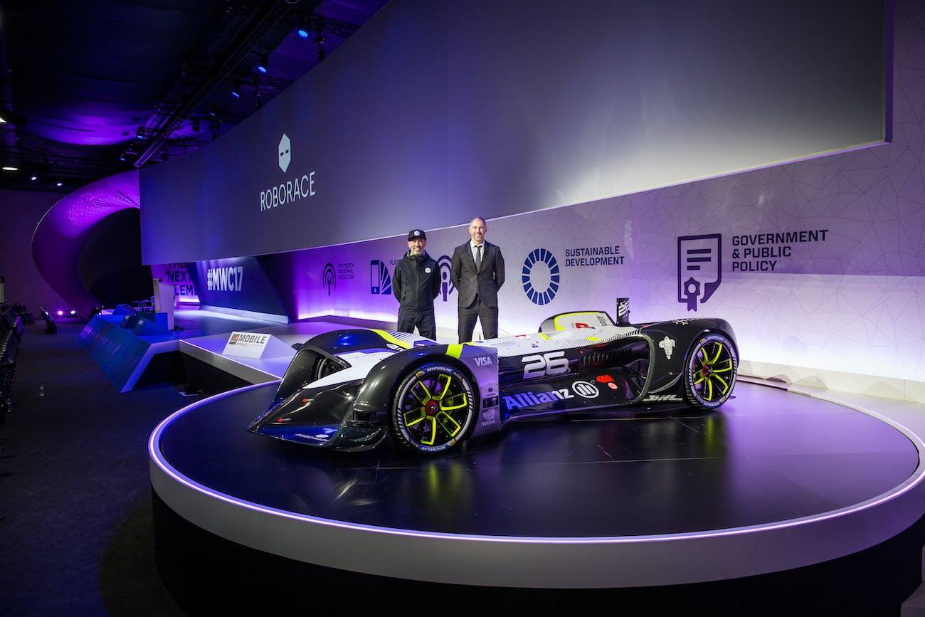 Denis Sverdlov, Roborace CEO, and Daniel Simon, Roborace chief design officer, stand next to the Robocar.