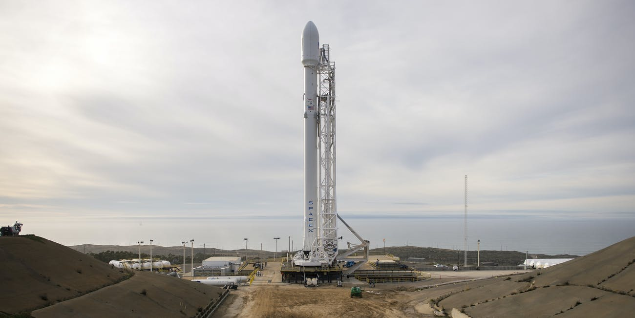 A Falcon 9 on the launchpad at Vandenberg Air Force Base.