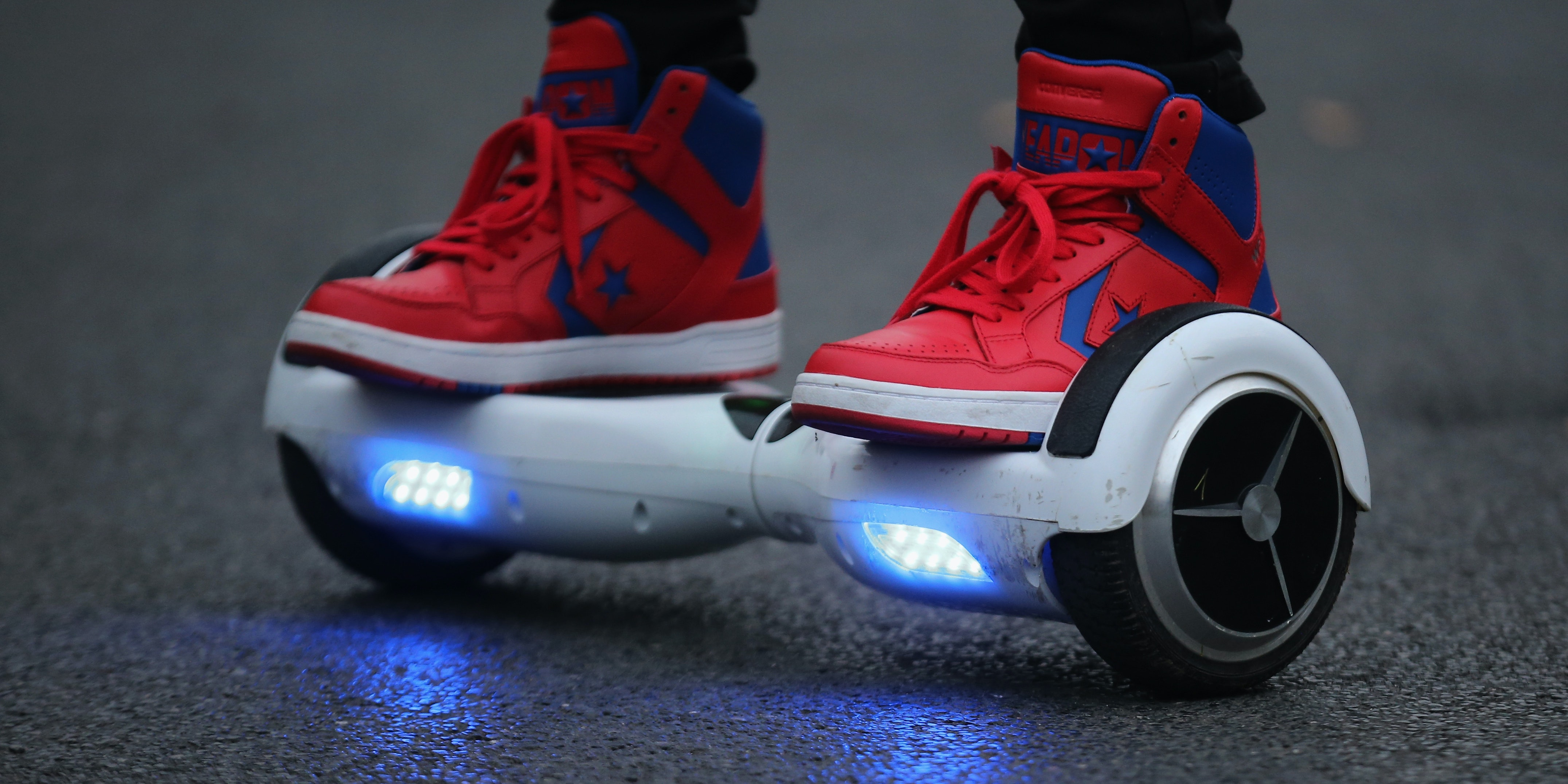 KNUTSFORD, ENGLAND - OCTOBER 13:  A youth poses as he rides a hoverboard, which are also known as self-balancing scooters and balance boards, on October 13, 2015 in Knutsford, England. The British Crown Prosecution Service have declared that the devices are illegal as they are are too unsafe to ride on the road, and too dangerous to ride on the pavement.  (Photo by Christopher Furlong/Getty Images)
