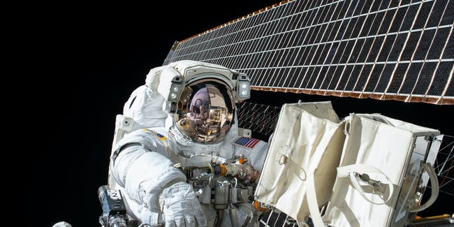 IN SPACE - NOVEMBER 6:  In this handout photo provided by NASA, NASA astronaut Scott Kelly works outside of the International Space Station during a spacewalk on November 6, 2015 in space. Kelly and fellow NASA astronaut Kjell Lindgren restored the port truss (P6) ammonia cooling system to its original configuration and returned ammonia to the desired levels in both the prime and back-up systems. The spacewalk lasted for seven hours and 48 minutes.. (Photo by NASA via Getty Images)