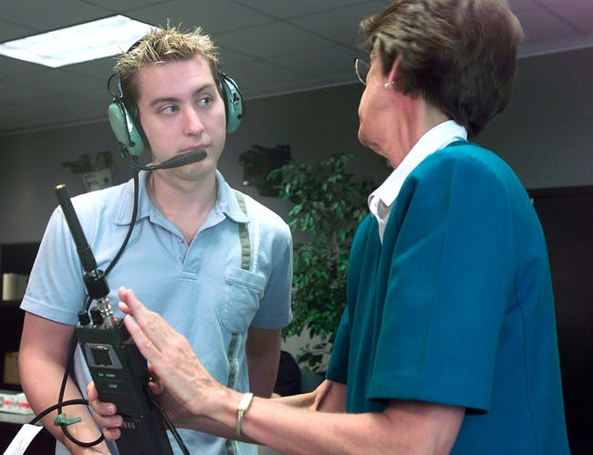 HOUSTON, TX ? AUGUST 27: Soyuz 5 nominated space flight participant and N?Sync member Lance Bass (L) is given HAM radio instructions from Carolynn Conley at Johnson Space Center August 26, 2002 in Houston, Texas. Bass won the endorsements from NASA and other agencies to fly to the space station this fall. A financial agreement still remains to be reached between Bass and the Russian space program. A round trip to the space station will run about $20 million. (Photo by NASA/Getty Images)