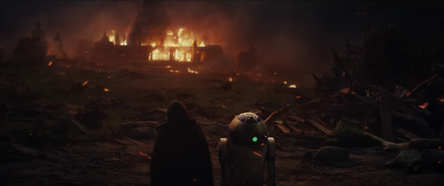 Luke and R2-D2 standing among the rubble of, possibly, Luke's fallen Jedi Academy.