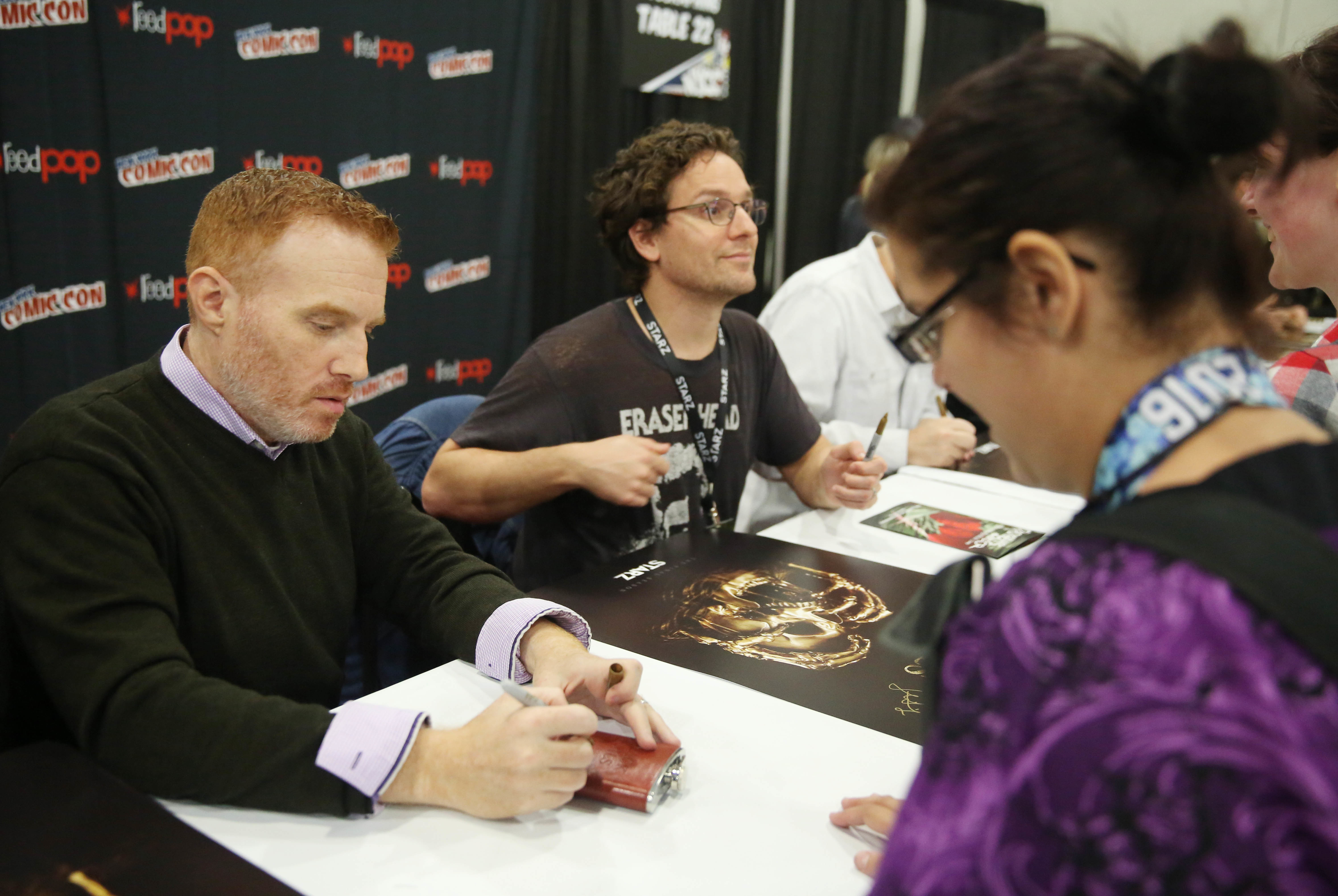 'Black Sails' showrunners Jonathan Steinberg and Robert Levine sign autographs for fans