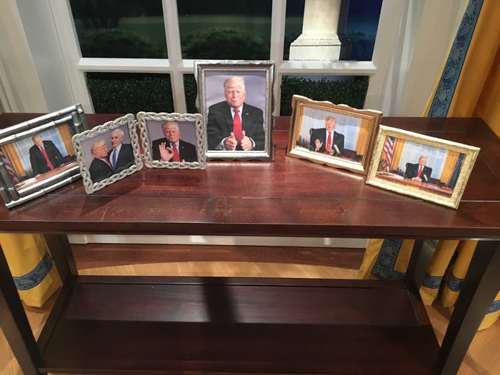 """Photos behind """"Donald Trump's"""" desk at 'The President Show'"""