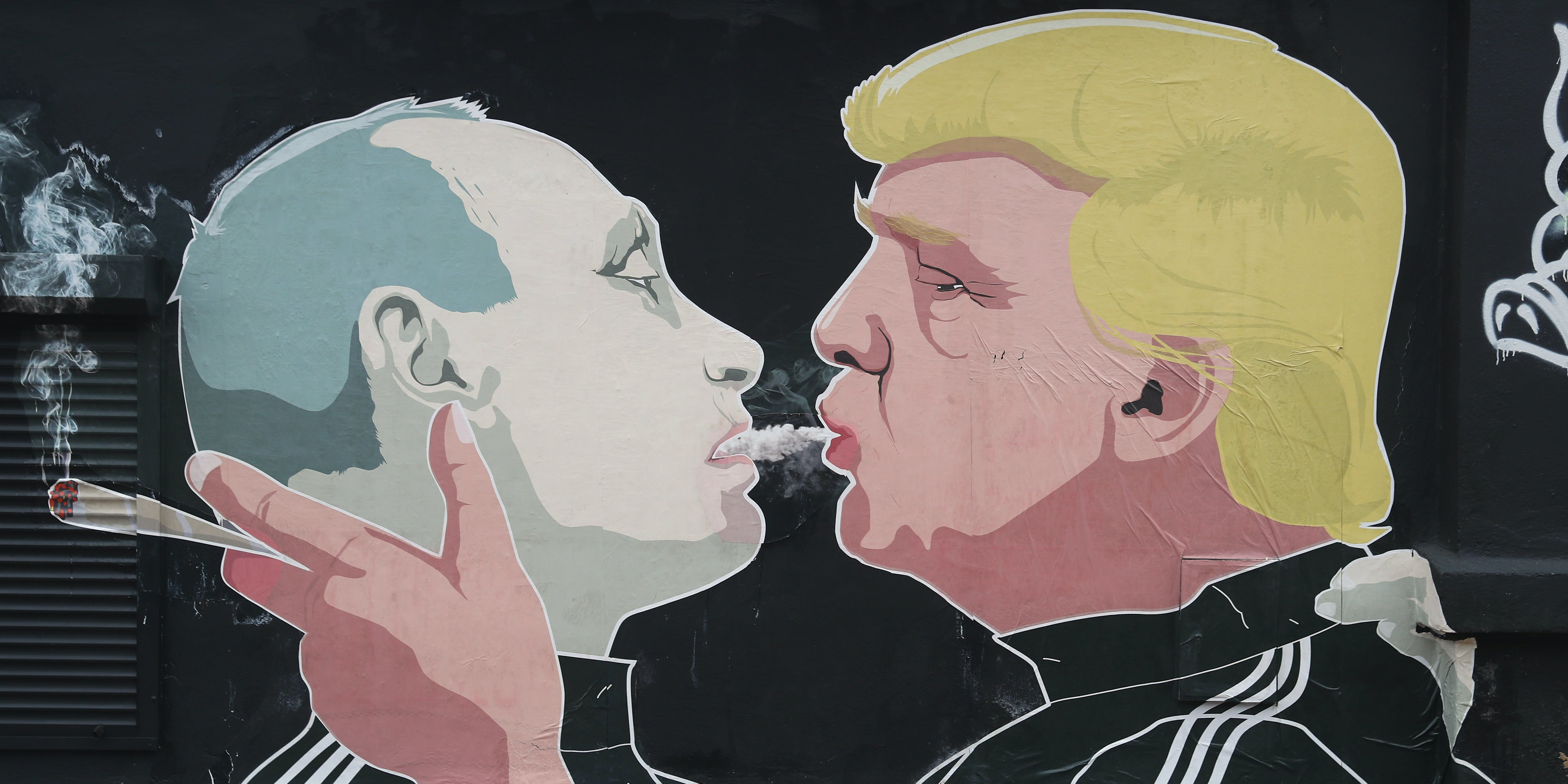A mural depicts U.S. President-elect Donald Trump (R) blowing marijuana smoke into the mouth of Russian President Vladimir Putin on the wall of a bar-b-que restaurant on November 23, 2016 in Vilnius, Lithuania. Many people in the three Baltic nations of Lithuania, Latvia and Estonia are concerned that Russia, because Trump has expressed both admiration for Putin and doubt over defending NATO member states, will be emboldened to intervene militarily in the Baltics.