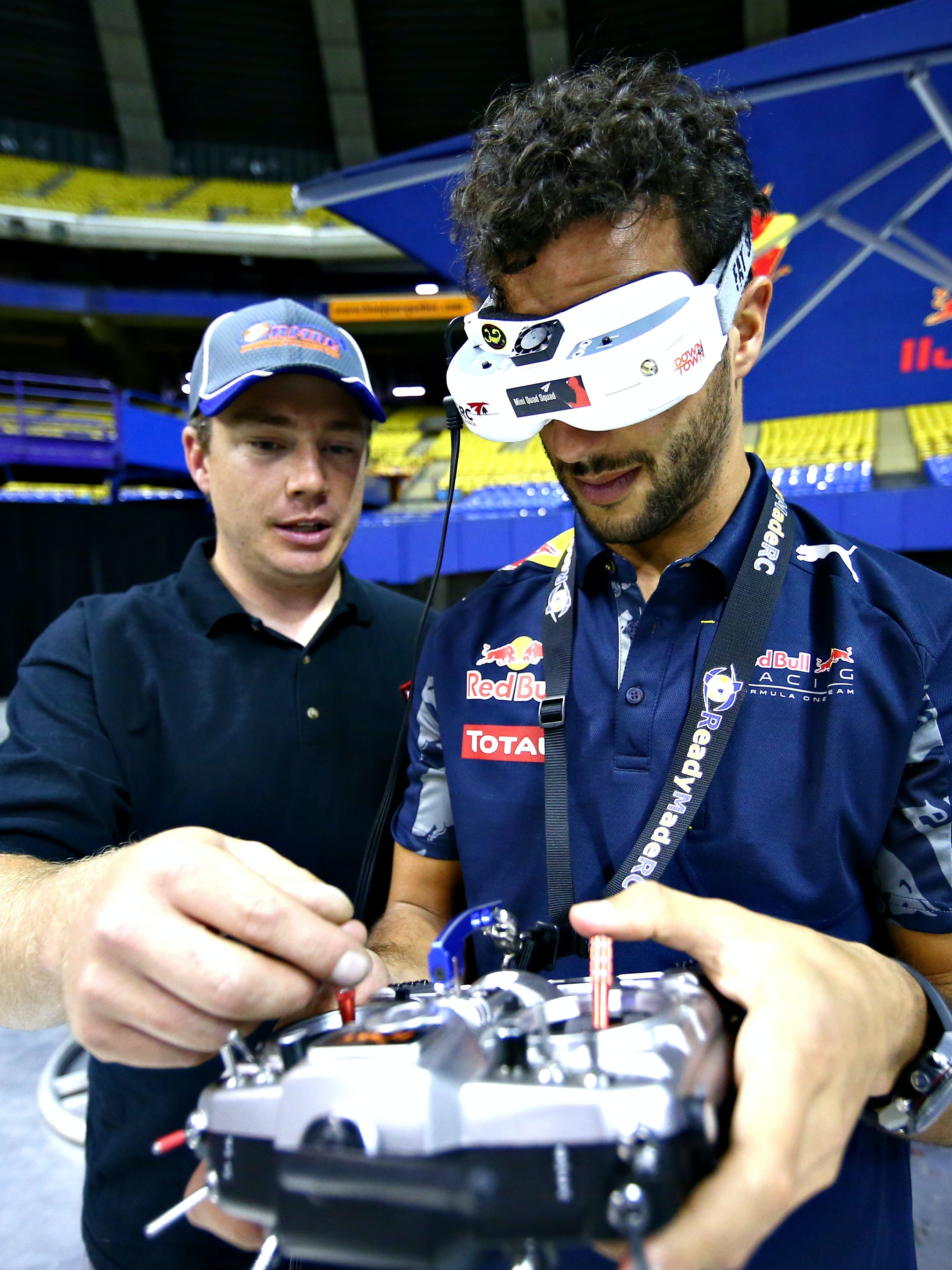 MONTREAL, QC - JUNE 08:  Daniel Ricciardo of Australia and Red Bull Racing races a drone during previews to the Canadian Formula One Grand Prix at Circuit Gilles Villeneuve on June 8, 2016 in Montreal, Canada.  (Photo by Dan Istitene/Getty Images)