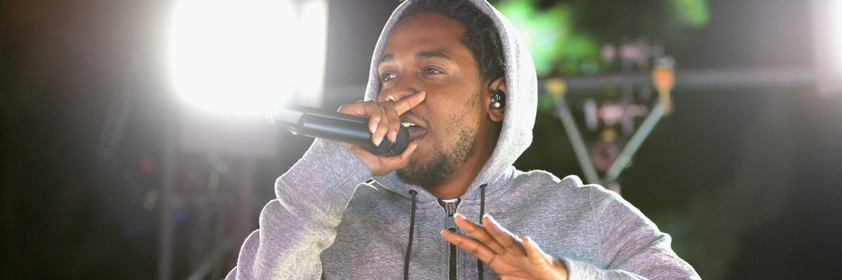 WEST HOLLYWOOD, CA - MARCH 24:  Recording artist Kendrick Lamar performs at #GETPUMPED live event. Reebok And Kendrick Lamar Take Over The Streets Of Hollywood, Fusing Fitness And Music With A Ground-Breaking Event on March 24, 2015 in West Hollywood, California.  (Photo by Chris Weeks/Getty Images for Reebok)