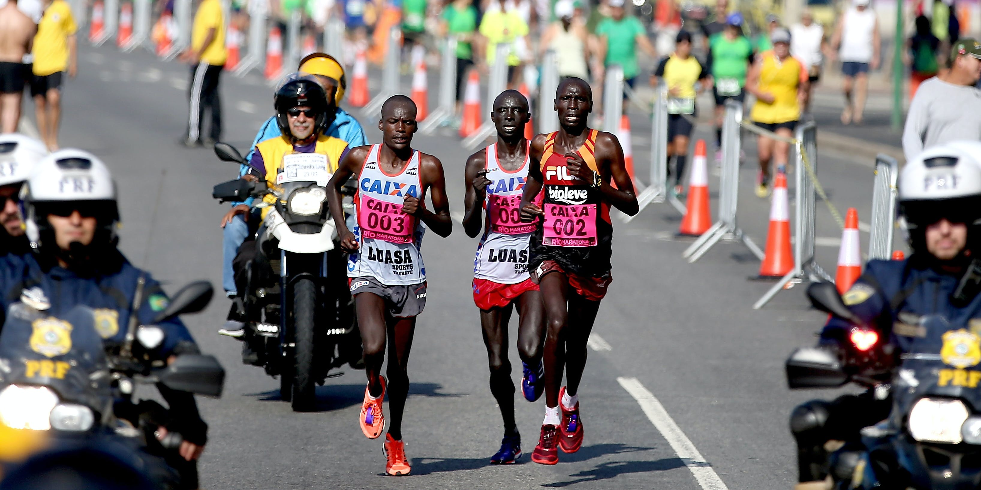 RIO DE JANEIRO, BRAZIL - MAY 29:  Elijah Kipkemei Kemboi #003 of Kenya, Will Kangogo Kimutai #001 of Kenya and Dickson Kimeli Cheruiyot #002 of Kenya run through Copacabana during the Rio de Janeiro Marathon, on May 29, 2016 in Rio de Janeiro, Brazil.  (Photo by Matthew Stockman/Getty Images)