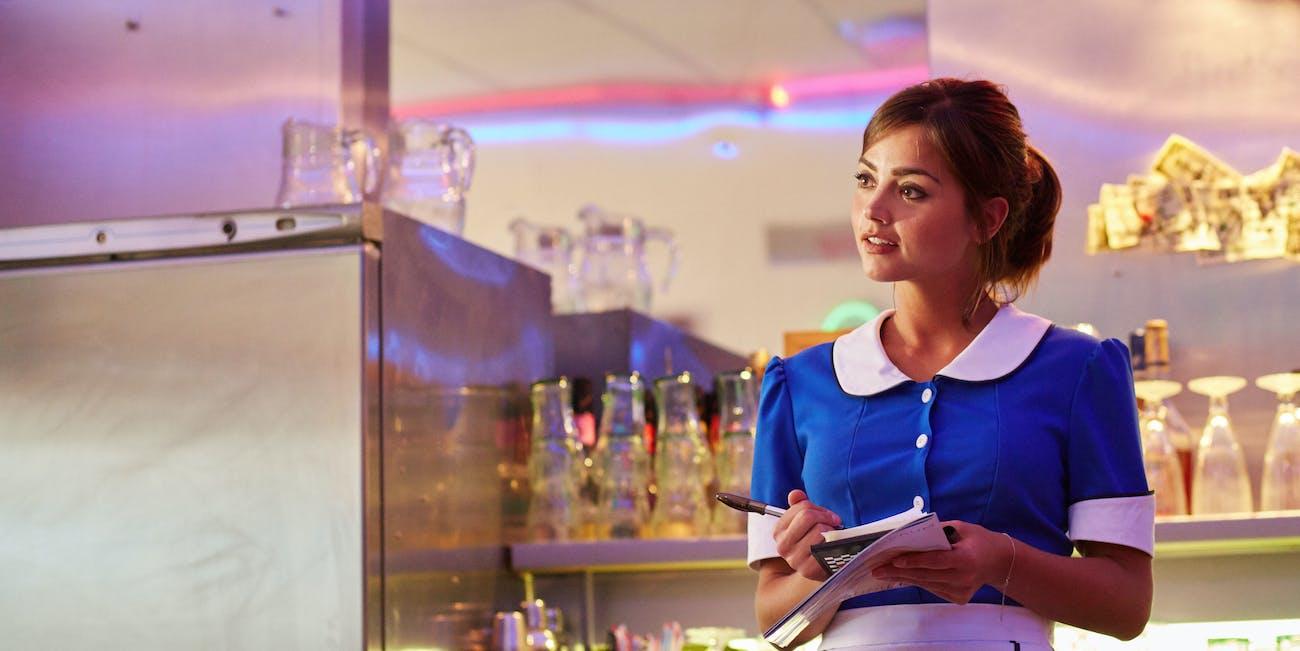 "Clara posing as a waitress in ""Hell Bent."""