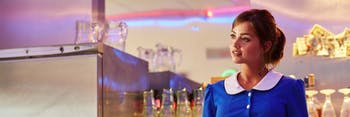"Clara posing as a waitress in ""Hell Bent."""