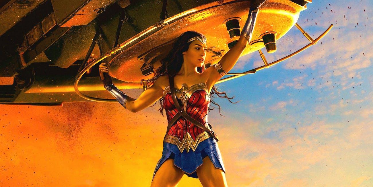 Wonder Woman holding a tank.