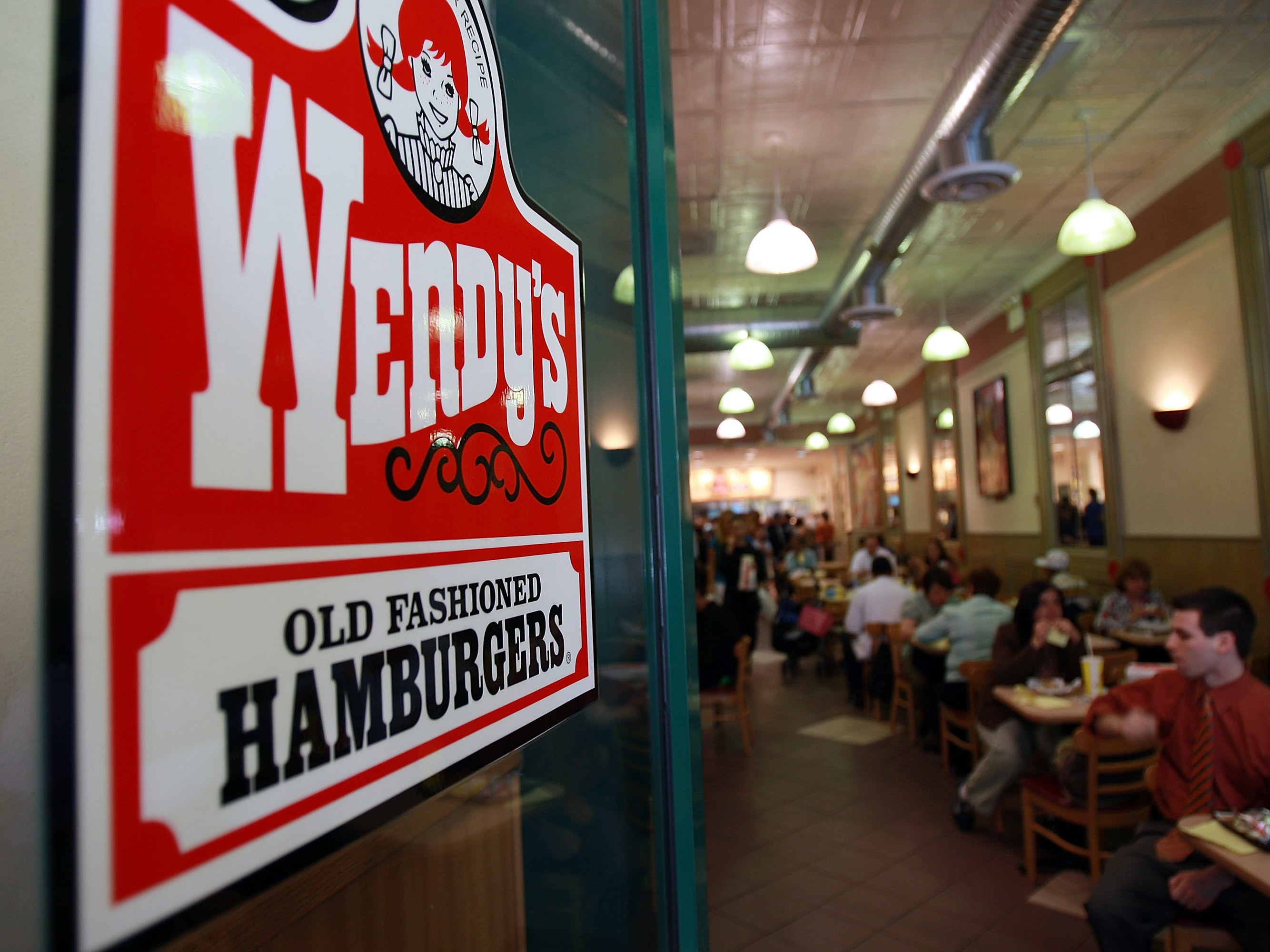 People eat in a Wendy's April 24, 2008 in New York City. Wendy's International Inc., which is the nation's No. 3 hamburger chain, was bought by Triarc Companies for about 2.3 billion dollars in an all-stock deal.