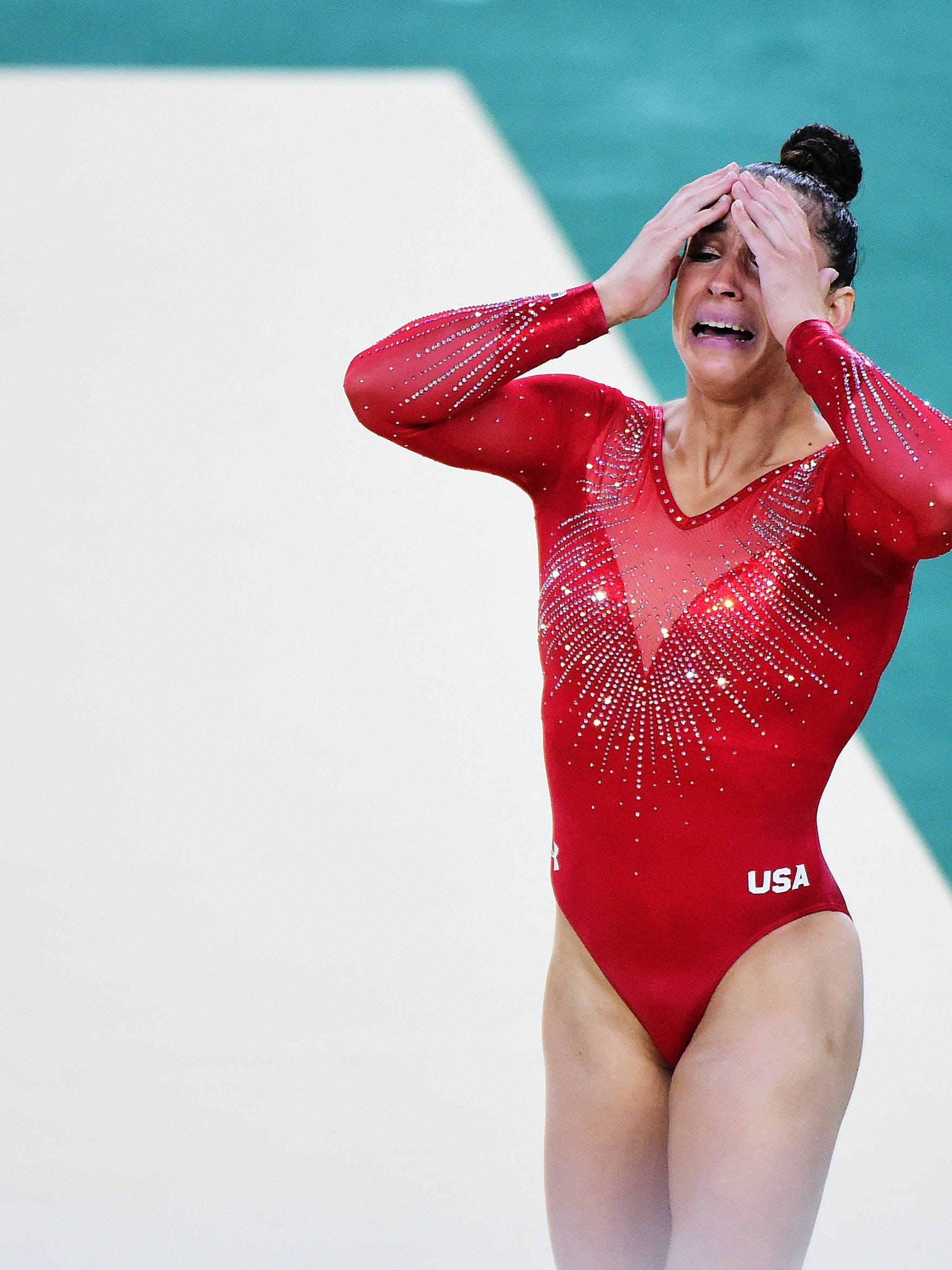 RIO DE JANEIRO, BRAZIL - AUGUST 11:  Alexandra Raisman of the United States reacts after competing on the floor during the Women's Individual All Around Final on Day 6 of the 2016 Rio Olympics at Rio Olympic Arena on August 11, 2016 in Rio de Janeiro, Brazil.  (Photo by Harry How/Getty Images)