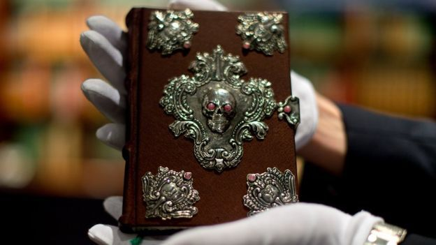 The special edition of 'Beetle the Bard' was handwritten by J.K. Rowling, and is bound in brown morocco leather and adorned with semi-precious stones.