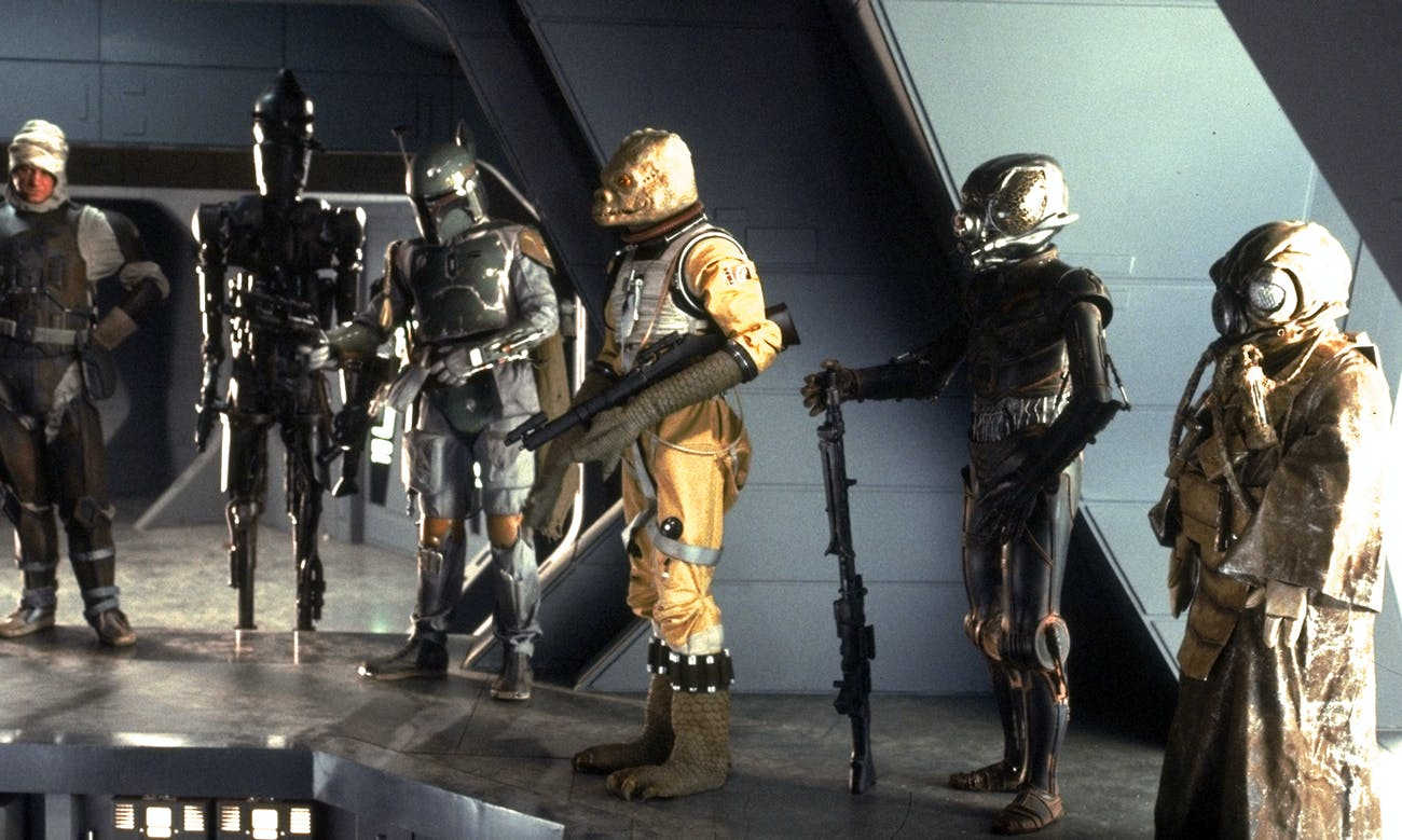 Bossk, the reptile guy, hanging out with other Bounty Hunters in 'The Empire Strikes Back'