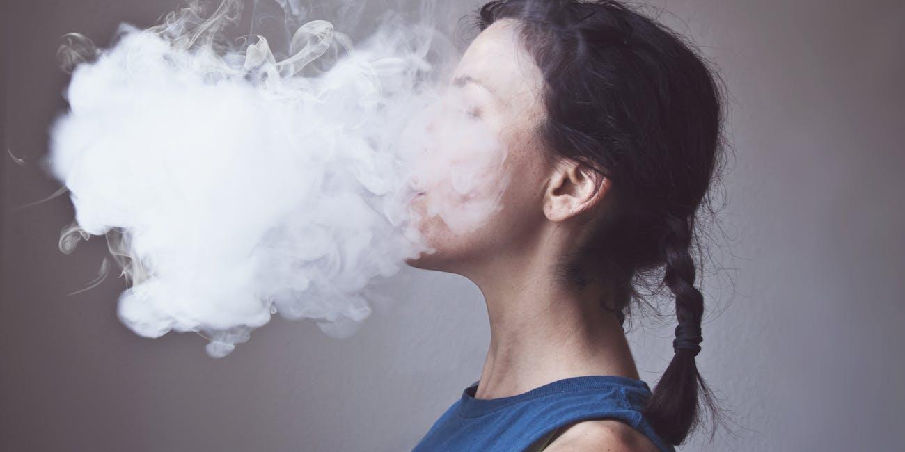 Woman smoking electronic cigarette creating cloud of vapor E-Cigarette | Electronic Cigarette | E-Cigs | E-Liquid | Vaping | Cloud Chasing