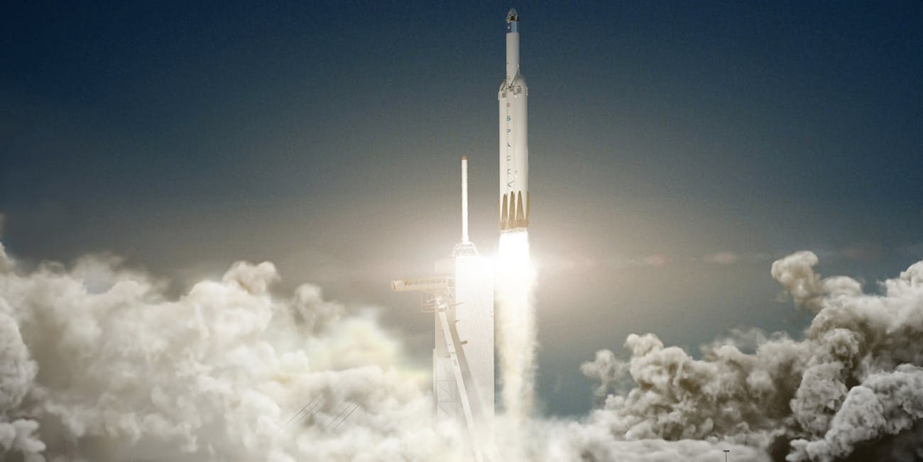 A rendering of the Falcon Heavy rocket carrying the Dragon 2 capsule off the launchpad.