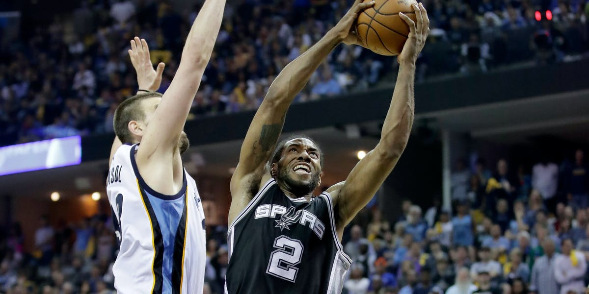 MEMPHIS, TN - APRIL 22:  Kawhi Leonard #2 of the San Antonio Spurs shoots the ball against the Memphis Grizzlies in game four of the Western Conference Quarterfinals during the 2017 NBA Playoffs at FedExForum on April 22, 2017 in Memphis, Tennessee.   NOTE TO USER: User expressly acknowledges and agrees that, by downloading and or using this photograph, User is consenting to the terms and conditions of the Getty Images License Agreement  (Photo by Andy Lyons/Getty Images)
