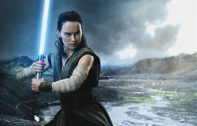 Rey (Daisy Ridley) wields Luke Skywalker's old blue lightsaber in 'The Last Jedi'.