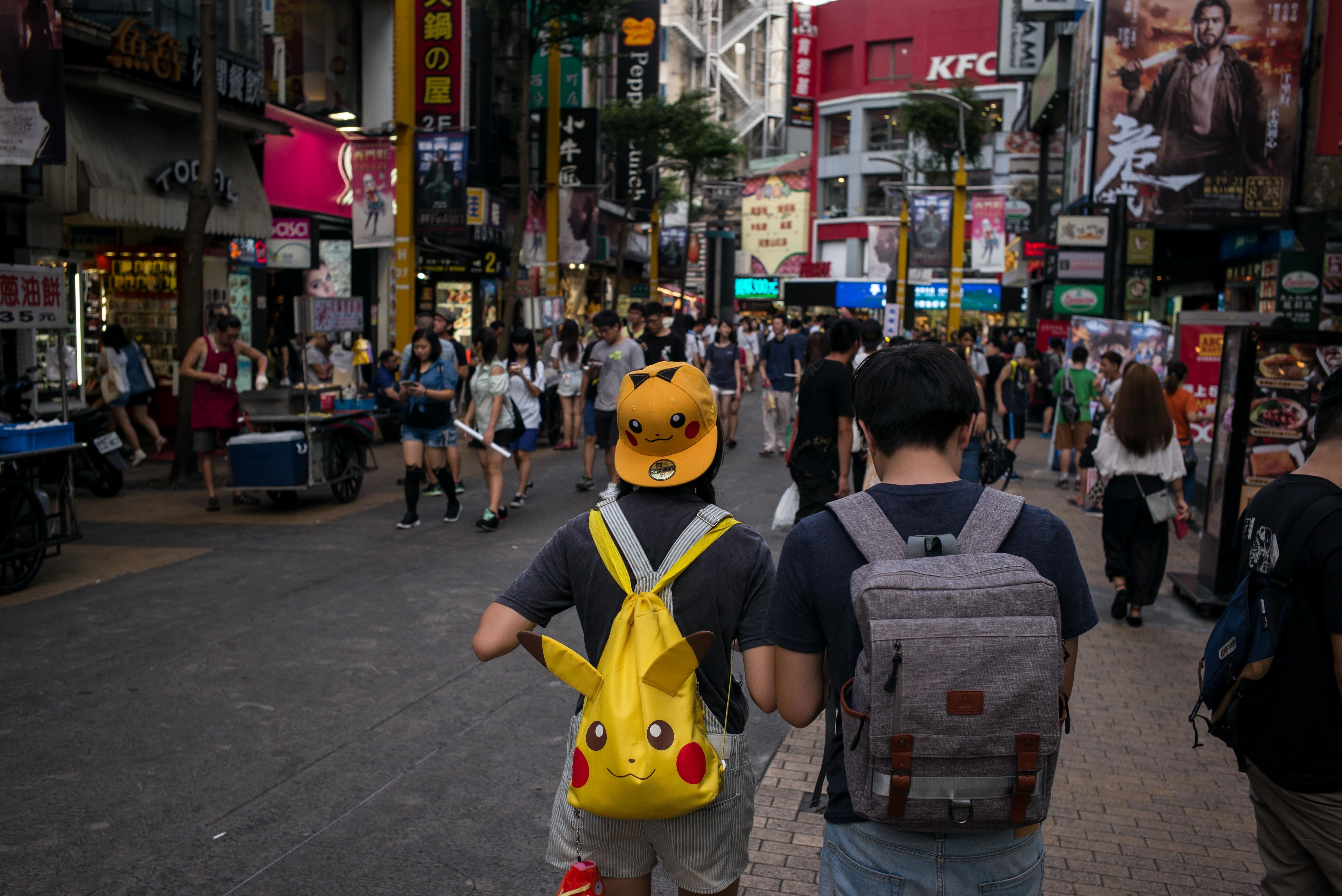 TAIPEI, TAIWAN - AUGUST 08:  People play Pokemon Go  on their smartphones on August 8, 2016 in Taipei, Taiwan. 'Pokemon Go,' which has been a smash-hit across the globe was launched in Taiwan on 6th August. Since its global launch, the mobile game has been an unexpected megahit among users who have taken to the streets with their smartphones.  (Photo by Billy H.C. Kwok/Getty Images)