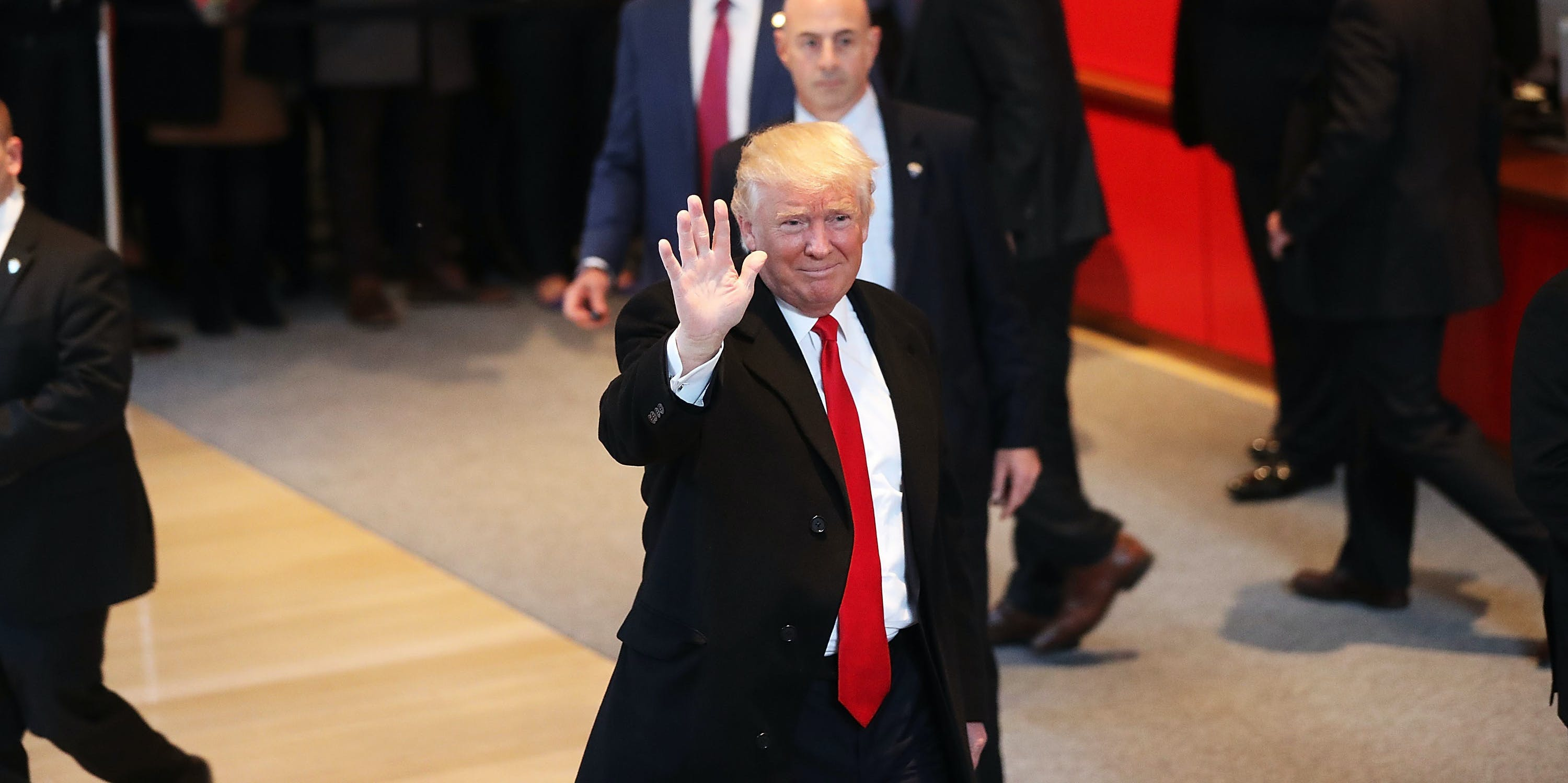 President-elect Donald Trump walks through the lobby of the New York Times following a meeting with editors at the paper on November 22, 2016 in New York City. Trump, who has held meetings with media executives over the last few days, has often had a tense relationship with many mainstream media outlets.