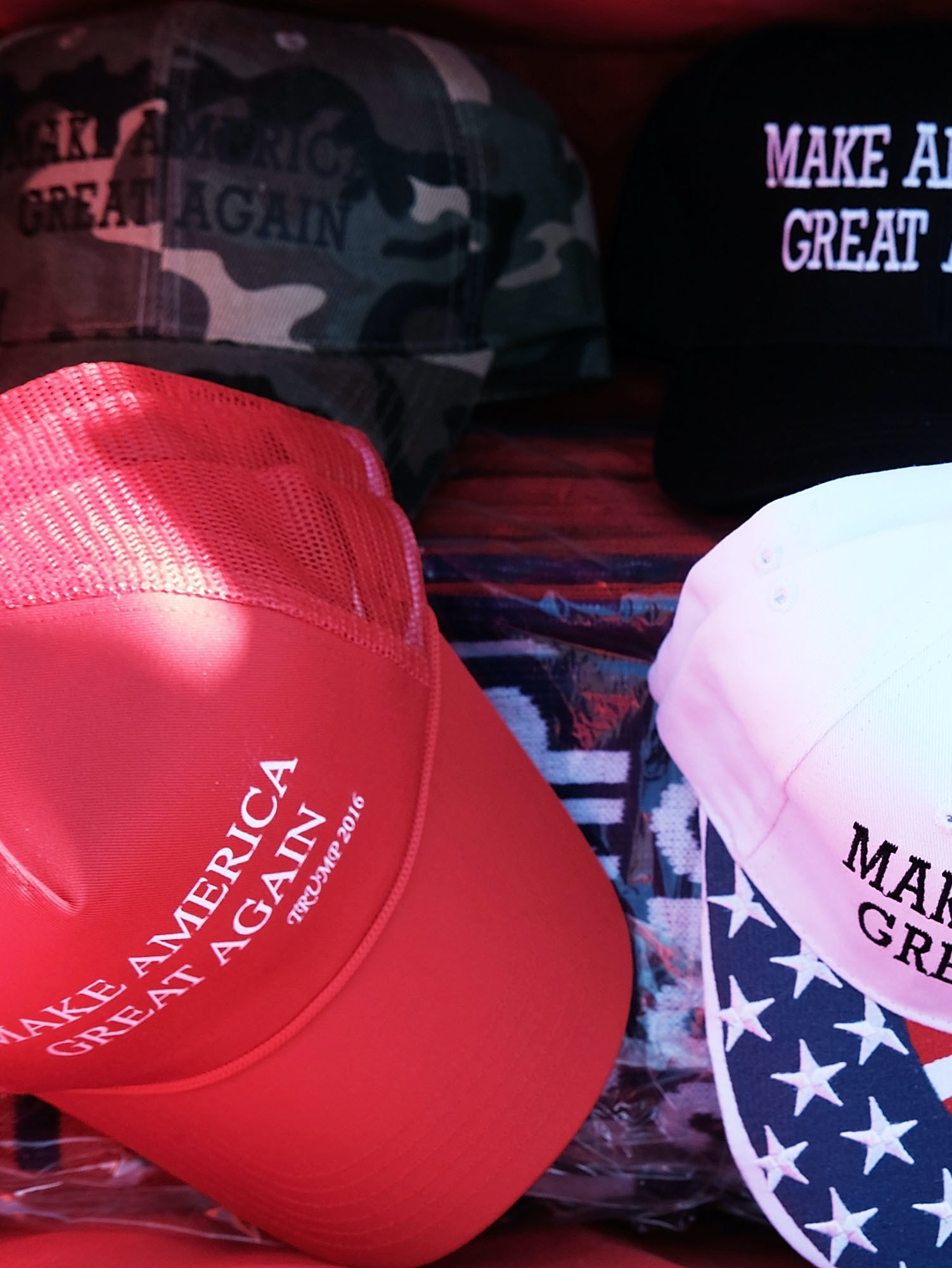 HERSHEY, PA - NOVEMBER 04:  Donald Trump 'Make America Great Again' hats are sold at a rally on November 4, 2016 in Hershey, Pennsylvania. Days before the presidential election, both Hillary Clinton and Donald Trump make their final pitches to the American people, with recent polls show a tightening race in crucial swing states.  (Photo by Spencer Platt/Getty Images)