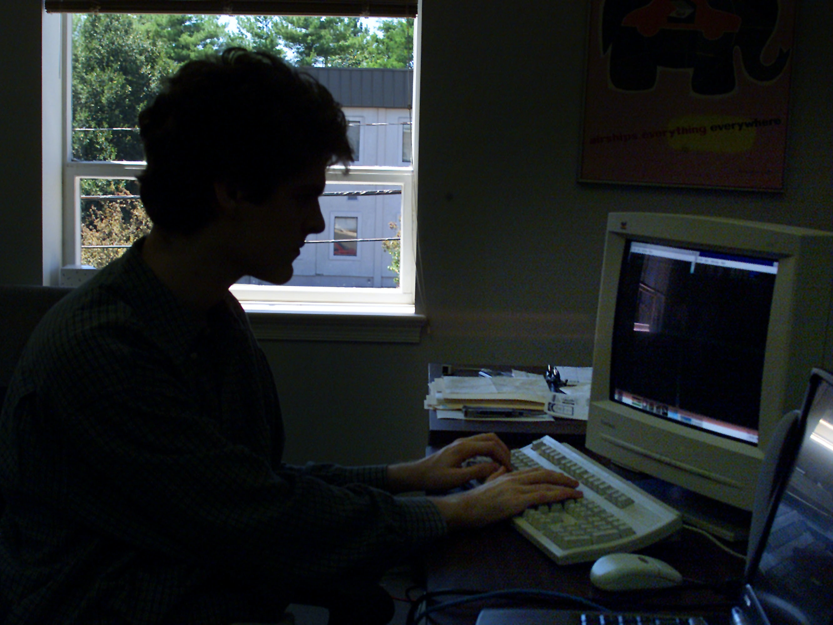 391546 04: Computer whiz kid Sean Ward works in his office July 6, 2001 in Alexandria, VA. Ward developed software that can give a song a unique digital fingerprint that will identify music quickly. When Napster goes back online later this summer, the song-sharing software will include Ward''s new fingerprint technology to prevent users from swapping copyrighted songs. (Photo by Mark Wilson/Getty Images)
