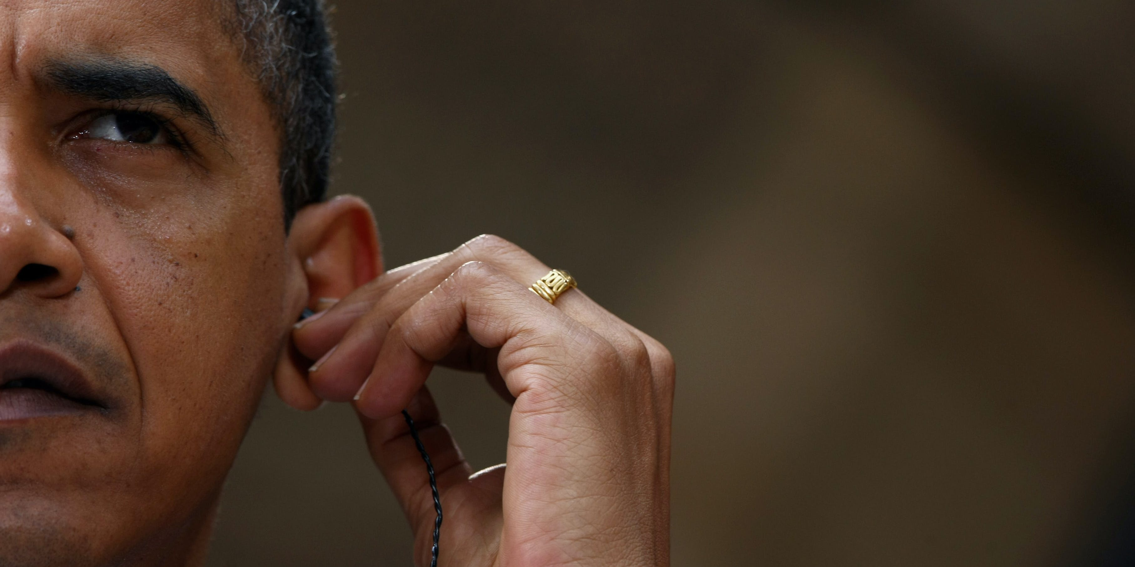 DRESDEN, GERMANY - JUNE 05:  U.S. President  Barack Obama sets his ear phone during a news conference on June 5, 2009 in Dresden, Germany. Obama will visit  Buchenwald, a former Nazi concentration camp, later today.  (Photo by Miguel Villagran/Getty Images)