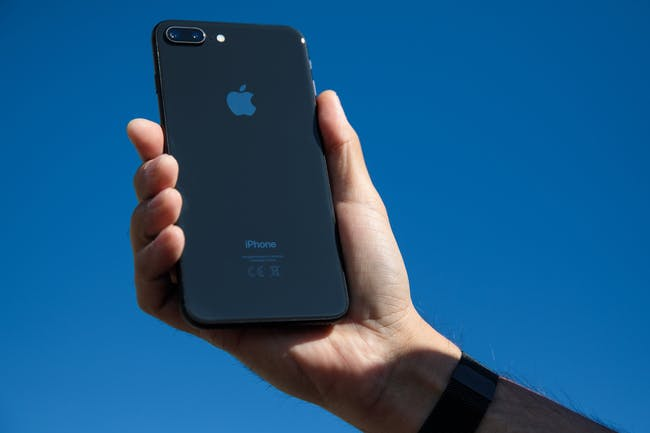 An iPhone 8 Plus is held for a photograph on September 22, 2017 in London, England.