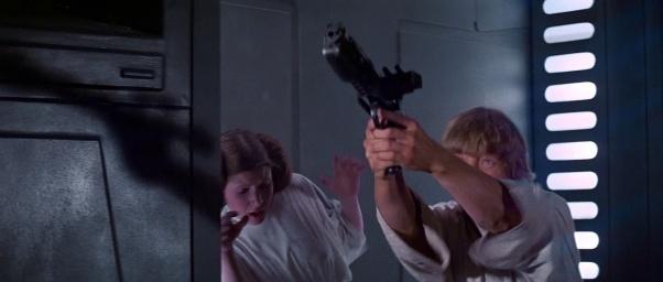 Luke, firing the classic Stormtrooper blaster.