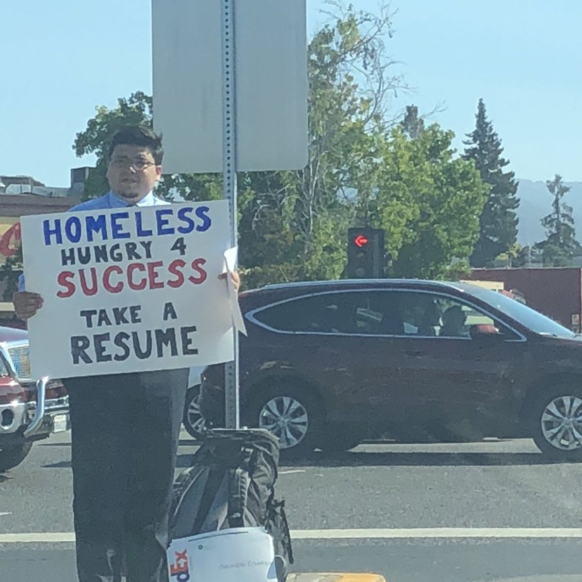 What the Homeless Resume Man Tells Us About Viral 'Feel Good' Memes