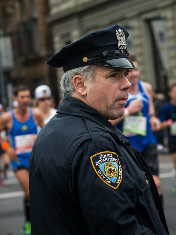 NEW YORK, NY - NOVEMBER 03:  A police officer monitors the ING New York City Marathon on November 3, 2013 in the Williamsburg neighborhood of the Brooklyn Borough of New York City. With the Boston Marathon bombing from earlier this year still fresh in many minds, security is especially high this year at the New York City marathon.  (Photo by Andrew Burton/Getty Images)