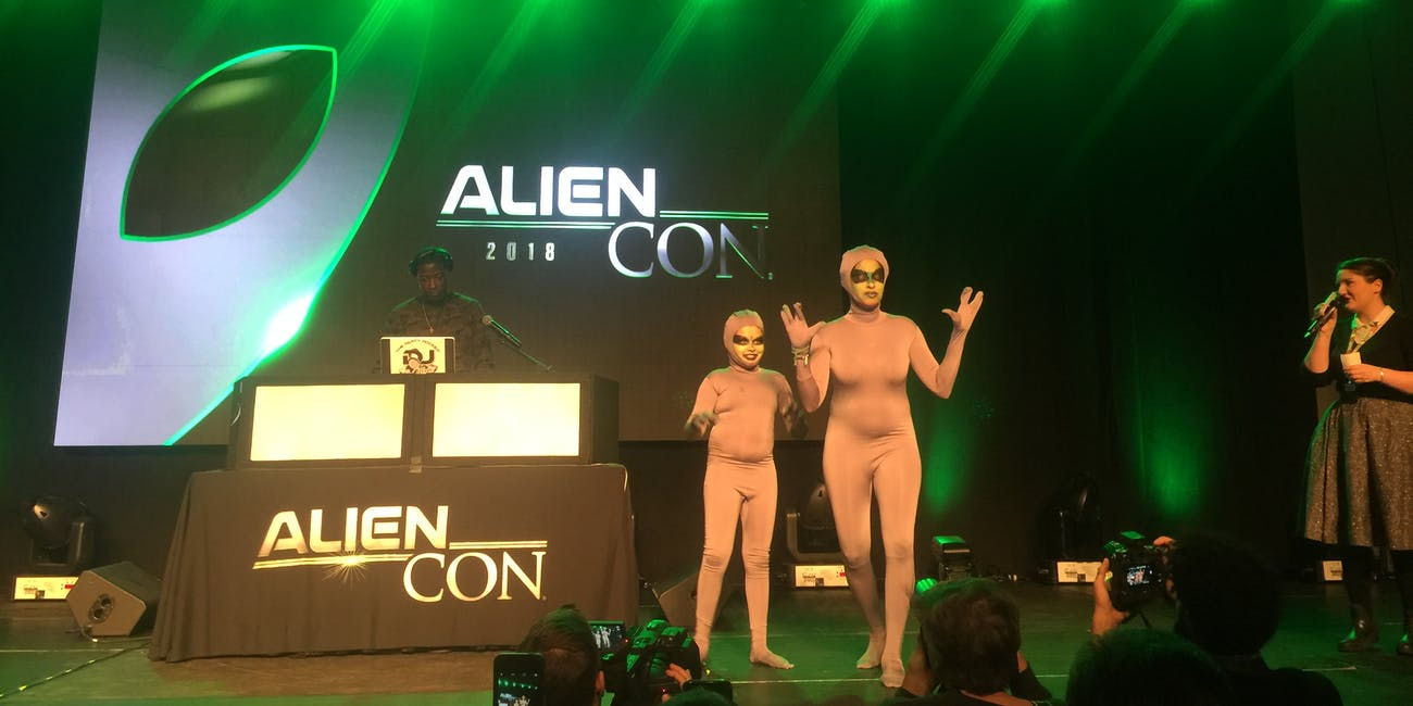 """A mother and daughter dressed as """"Grey aliens."""""""