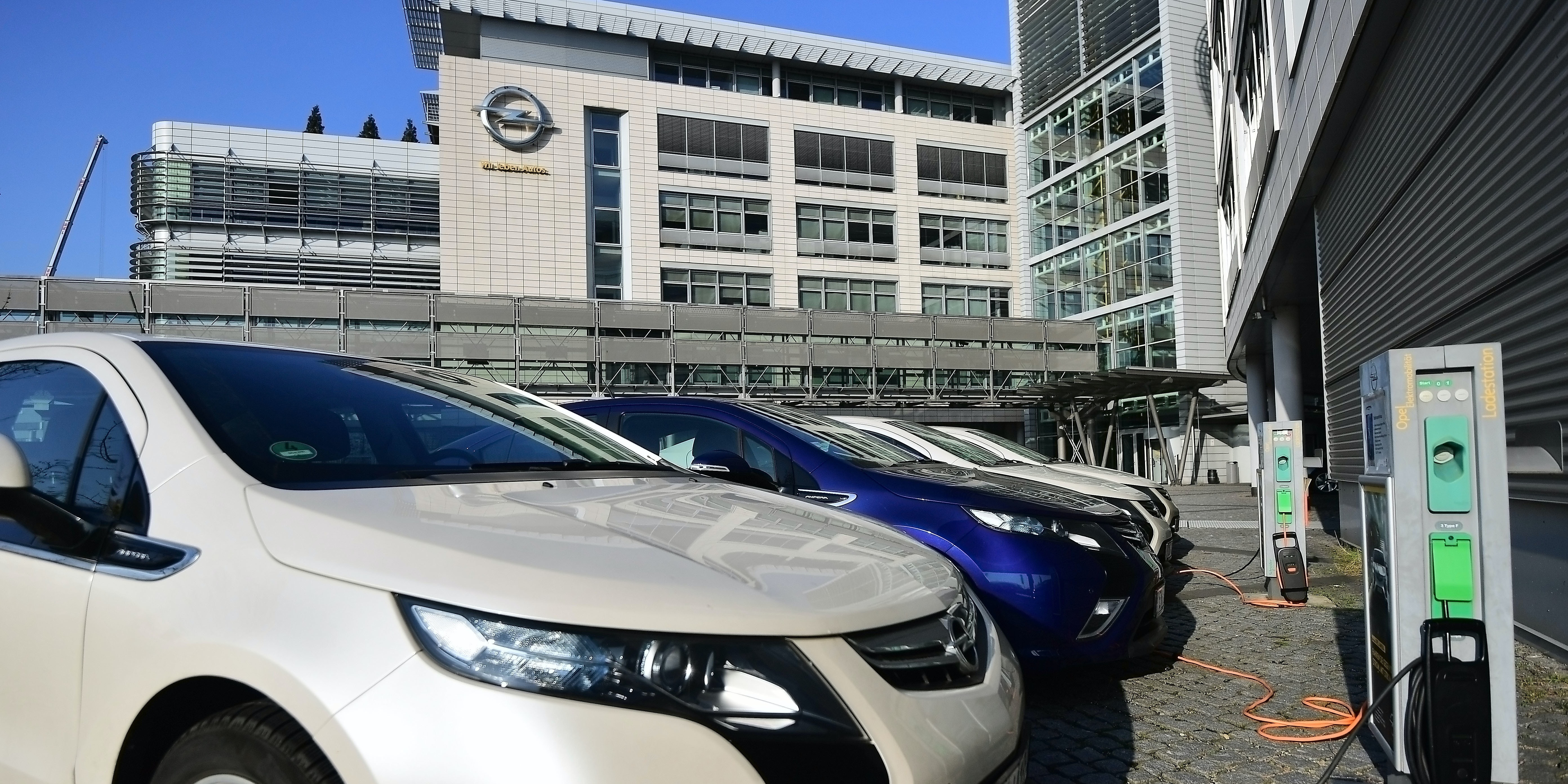 A general view to the Opel headquarters and 'Ampera' electric cars on February 15, 2017 in Ruesselsheim, Germany. PSA Peugeot Citroen is reportedly seeking to buy German automaker Opel from its parent company General Motors. The acquisition would require the consent of the German government, which would likely mean negotiations over job safeguards for Opel workers. General Motors has owned Opel since 1929.