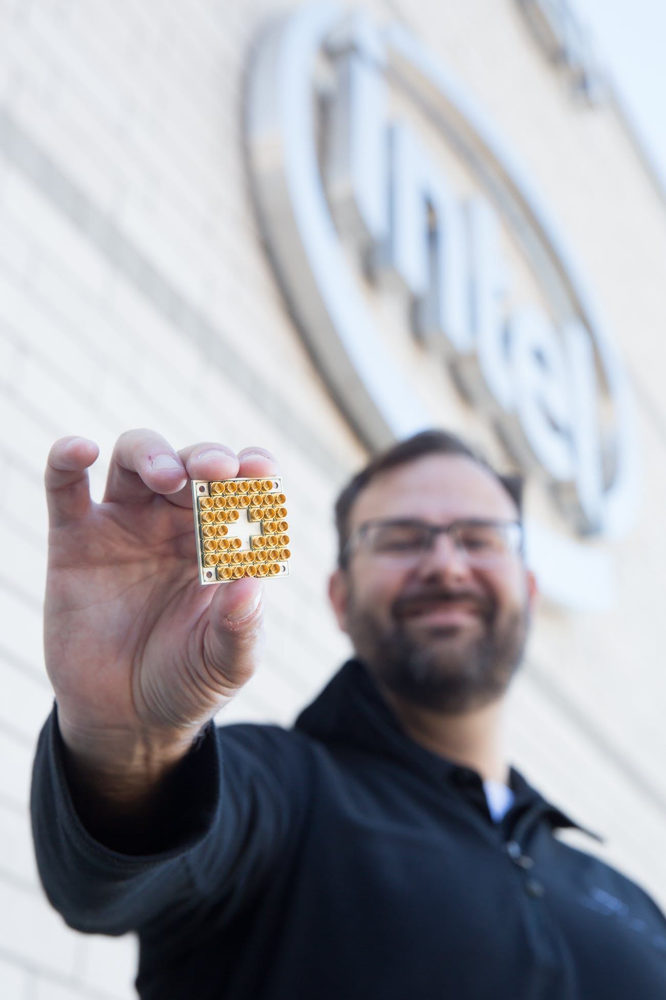 Intel's director of quantum hardware, Jim Clarke, holds the new 17-qubit superconducting test chip.