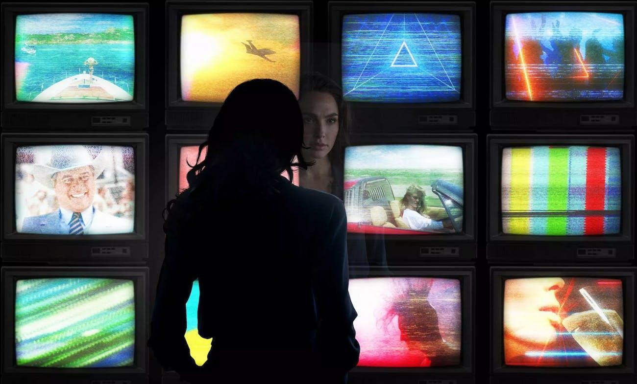 Wonder Woman watches TV.