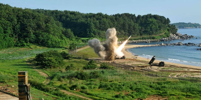EAST COAST, SOUTH KOREA - JULY 05: In this handout photo released by the United States Forces Korea, U.S. M270 Multiple Launch Rocket System (R) firing an MGM-140 Army Tactical Missile during a U.S. and South Korea joint missile drill aimed to counter North Korea¡¯s intercontinental ballistic missile test on July 5, 2017 in East Coast, South Korea. The U.S. Army and South Korean military responded to North Korea's missile launch with a combined ballistic missile exercise on Wednesday, into South Korean waters along the country's eastern coastline. (Photo by United States Forces Korea via Getty Images)