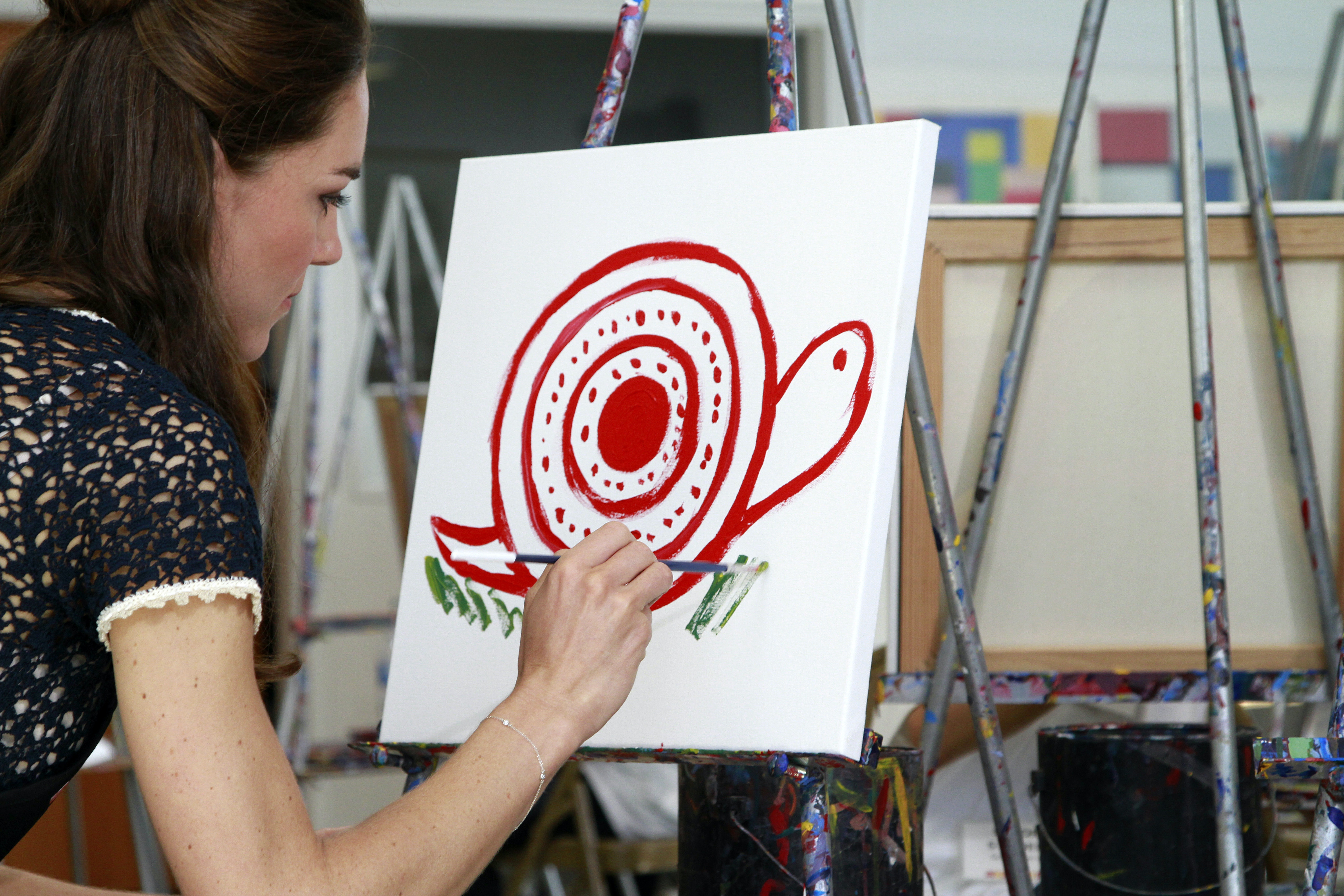 Catherine, Duchess of Cambridge paints a picture while attending an art class during their tour of the Inner City Arts campus on July 10, 2011 in the Skid Row section of Los Angeles, California. Prince William and his wife Catherine are on a royal visit to California from July 8 to July 10. (Photo by Liz O. Baylen - Pool/Getty Images)