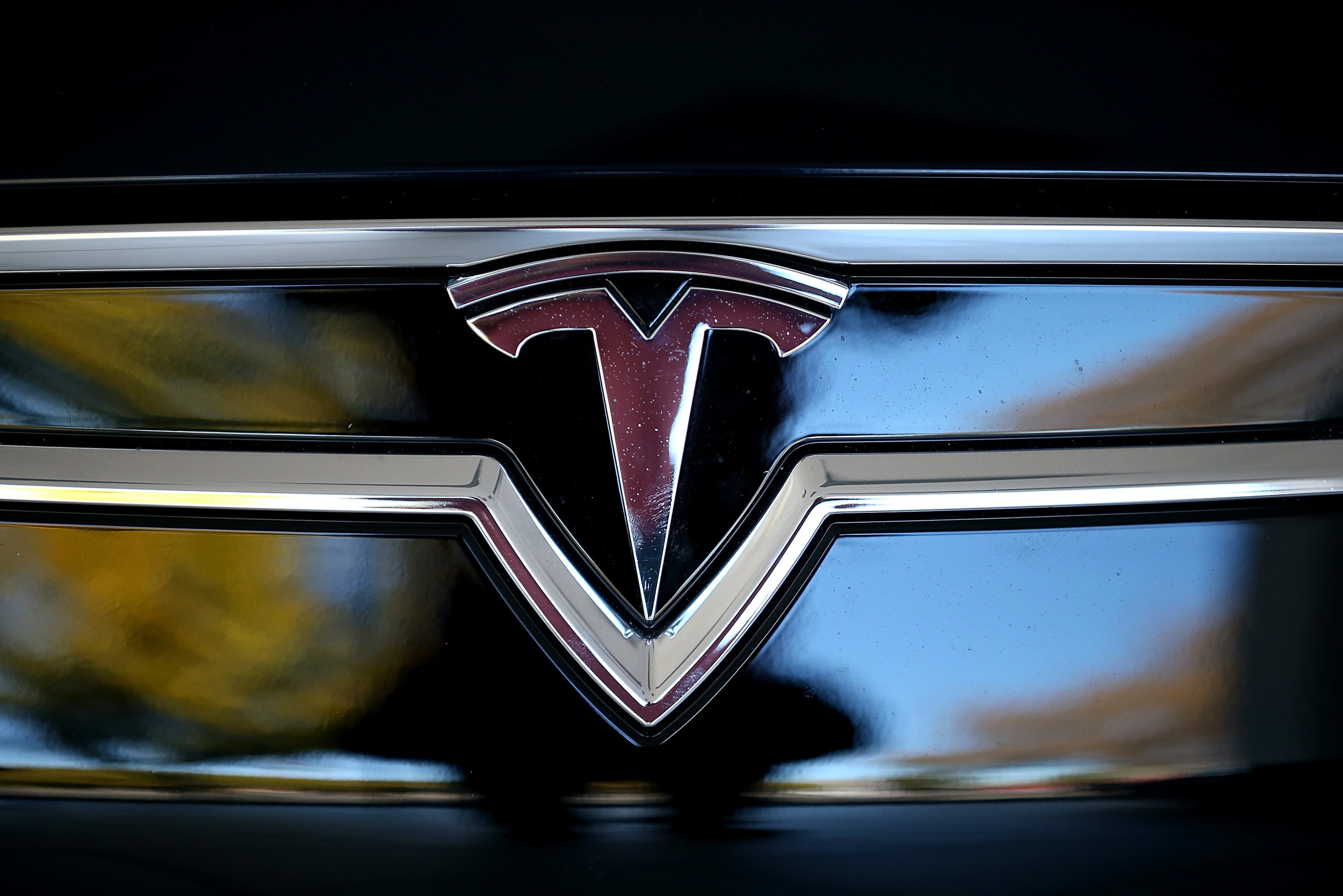 Here's what the Tesla logo looks like when it's not on an illegal drug.