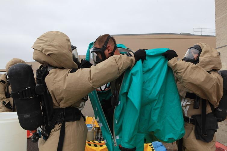 U.S. Marine Corps specialists performing decontamination procedures.