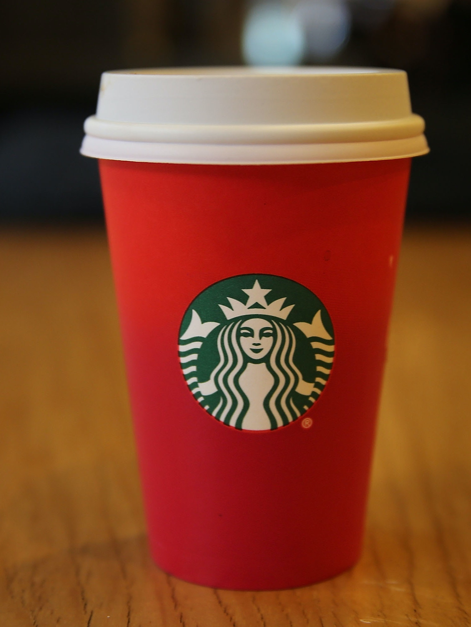NEW YORK, NY - NOVEMBER 12: A new holiday Starbucks cup is viewed on November 12, 2015 in New York City. The coffee giant has come under criticism by some for leaving any Christmas or traditional holiday signage off of the red cup. While Starbucks has said there is no cultural or political message to the design, critics claim that the company doesn't want to offend non-Christians or those who don't celebrate Christmas.  (Photo by Spencer Platt/Getty Images)