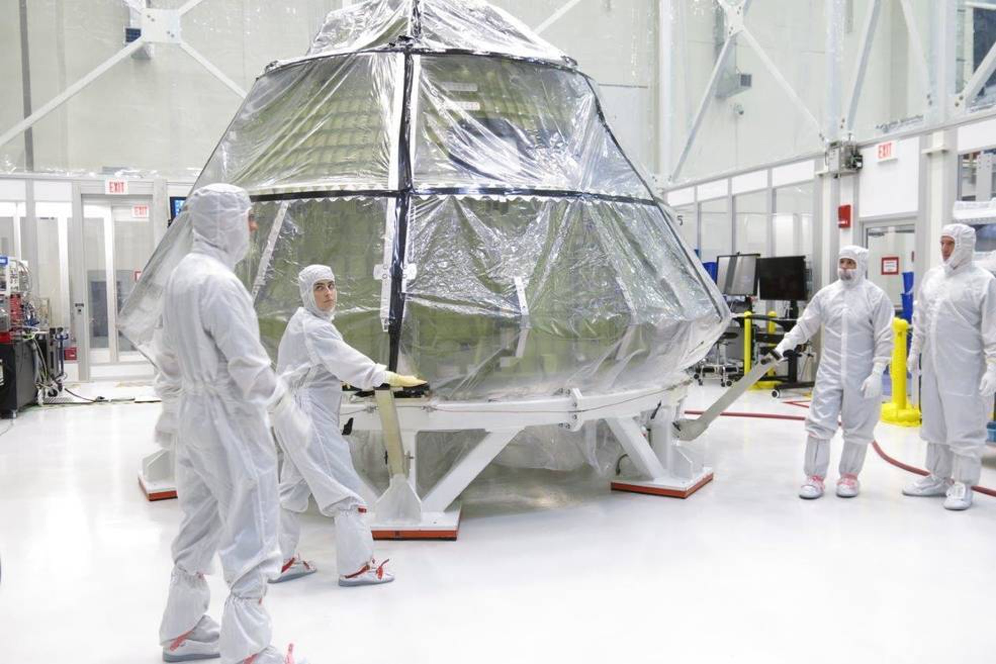 The Orion crew module for Exploration Mission 1 was transferred into the clean room inside the Neil Armstrong Operations and Checkout Building at Kennedy Space Center in late July to begin installation of the spacecraft's critical systems, including propellant lines.