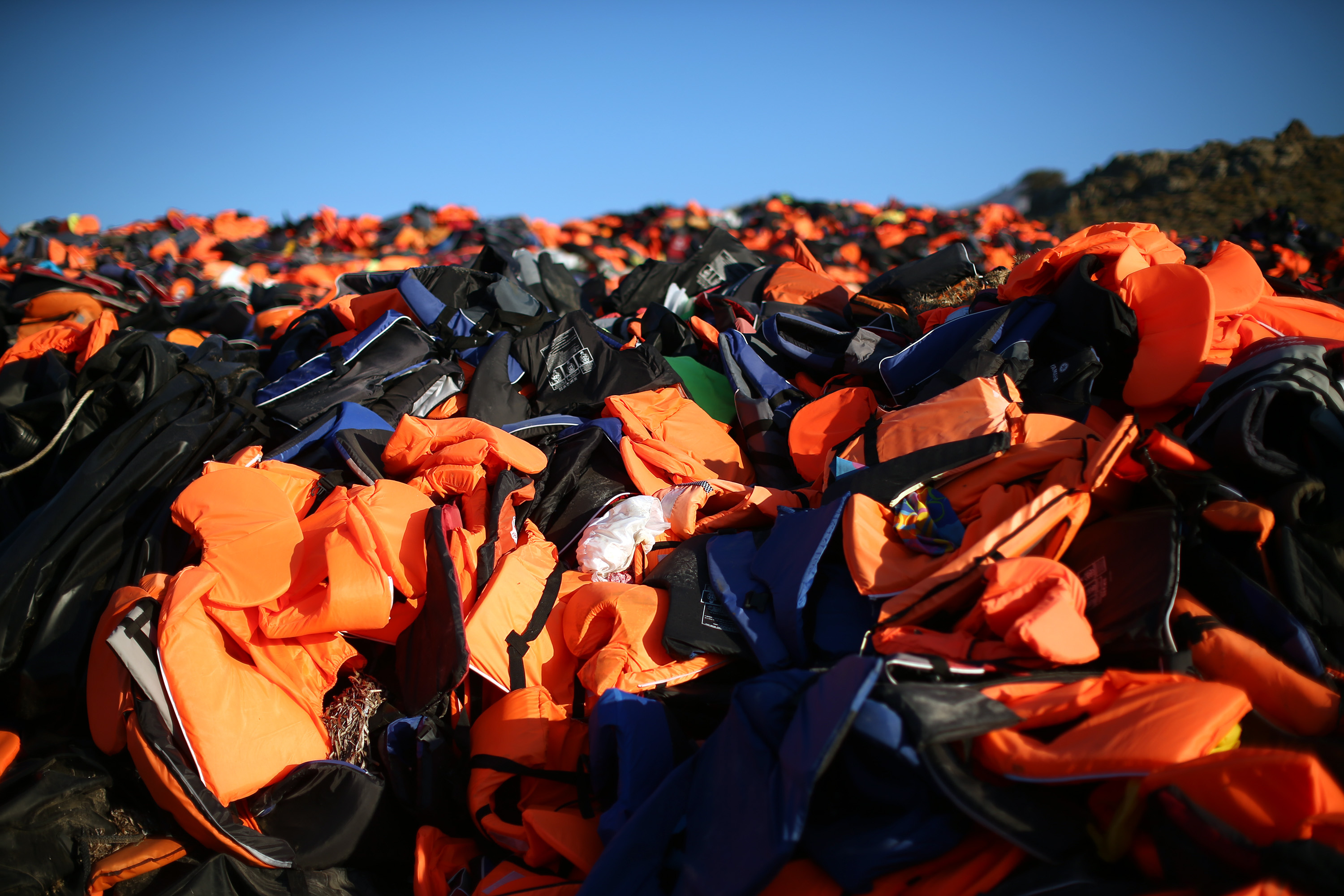 Life jackets abandoned by migrants who have made the crossing from Turkey to the Greek island of Lesvos are dumped on November 13, 2015 in Mithymna, Greece.
